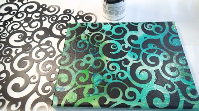 An idea for using your less than awesom acrylic poured paintings as a background using stencils to add on lettering or designs on top and letting the pour show through
