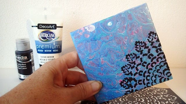 Using texture paste to add a stencilled design on to acrylic pour painted ceramic tiles. Video tutorial.
