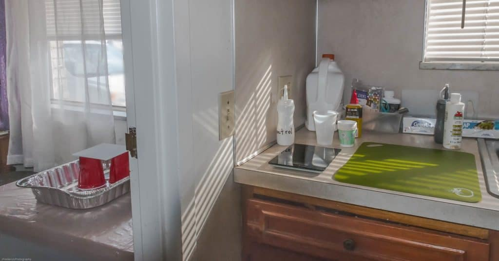 Only a wall separates the kitchen sink and dining room