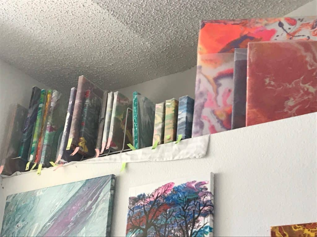 canvases on shelf
