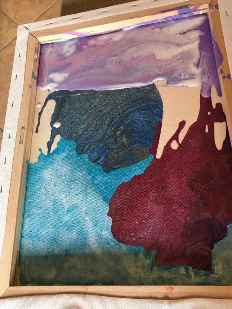 Pouring Purple on an Acrylic Collage