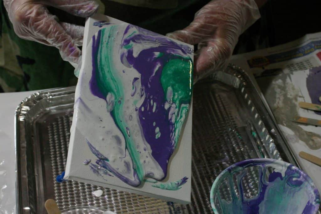 paint flowing over canvas acrylic pouring